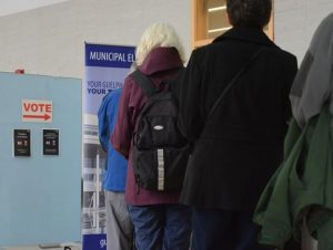 Voters line up at a Guelph polling station
