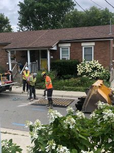 City workers install temporary speed bumps on Alice Street
